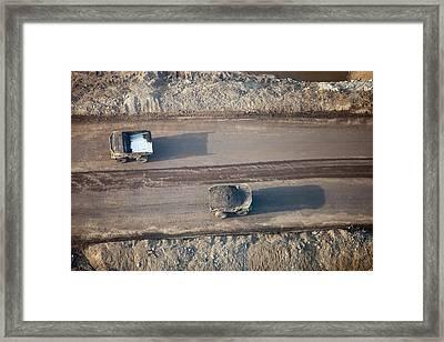 Massive Dump Trucks Loaded With Tar Sand Framed Print by Ashley Cooper