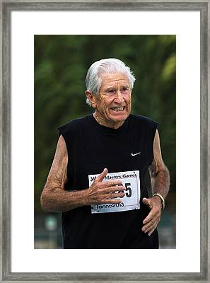 Masters Athlete Running Framed Print by Alex Rotas