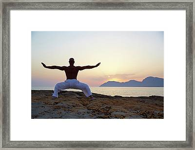 Mature Man Doing Tai Chi Framed Print