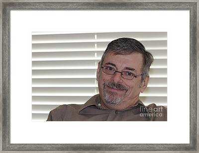Mature Man Looking At Viewer Framed Print