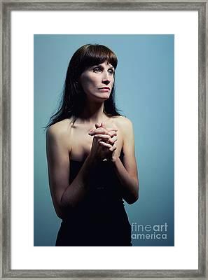 Mature Woman Prays Framed Print by Aleksey Tugolukov