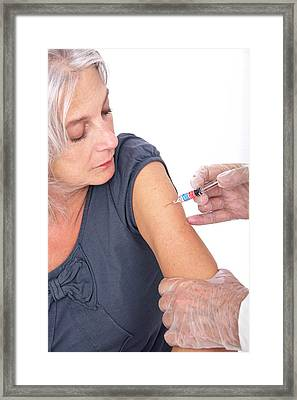 Mature Woman Receiving Vaccination Framed Print by Lea Paterson