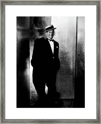 Maurice Chevalier Wearing A Boater Hat Framed Print