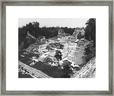 Mayan Ruins At Tikal Framed Print by Underwood Archives