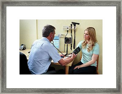 Measuring Blood Pressure Framed Print by Saturn Stills