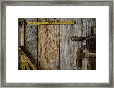 Measuring Tape Hammer And Saw On Rustic Old Wood Background Framed Print