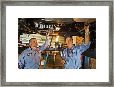 Mechanics Repairing Recreational Vehicle Framed Print by Jim West