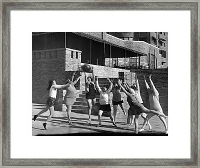 Medicine Ball Exercise Framed Print by Underwood Archives