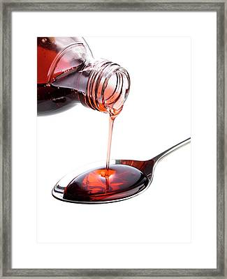 Medicine Being Poured Onto A Spoon Framed Print by Science Photo Library