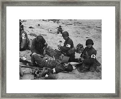 Medics Treat A Wounded U.s. Soldier Framed Print