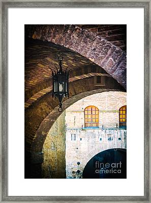 Framed Print featuring the photograph Medieval Arches With Lamp by Silvia Ganora