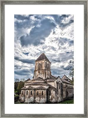 Medieval Monastery Under Swirling Clouds Framed Print by Nila Newsom