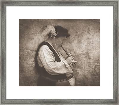 Medieval Flute Player Framed Print by Pat Abbott