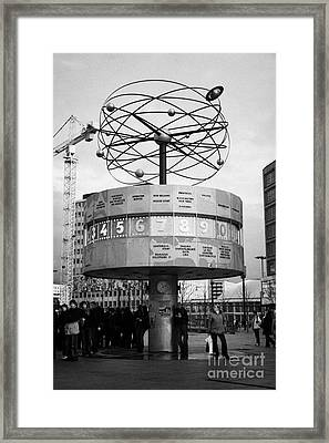 meeting place at the world clock Weltzeituhr at Alexanderplatz with reconstruction work in background east Berlin Germany Framed Print by Joe Fox