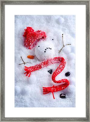 Melted Snowman Framed Print
