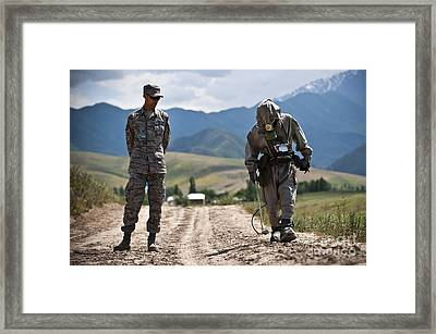 Member Of The Kyrgyz Republic Searches Framed Print by Stocktrek Images