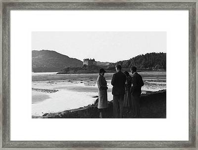 Men And Women Standing On A Bank Of A Lake Framed Print