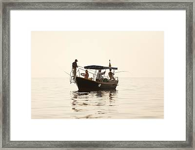 Men Go Fishing From A Boat Framed Print by Serhii Odarchenko