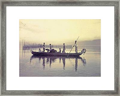 Men In A Canoe In The Bay Of Ambon, Indonesia Framed Print