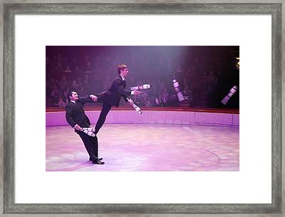 Men In Suits Juggling Framed Print