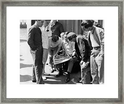 Men Looking At A Newspaper Framed Print by Underwood Archives