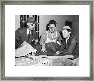 Men Looking At Blueprints Framed Print