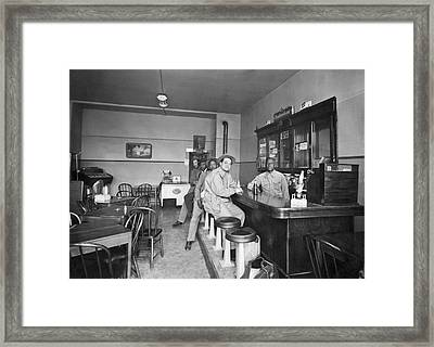 Men Sitting At A Bar Framed Print by Underwood Archives