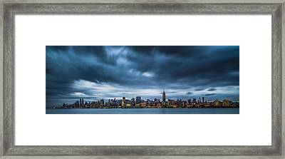 Menacing Sky Over Manhattan Framed Print by Chris Halford