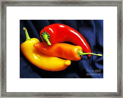 Menage A Trois Peppers I Framed Print by Nancy Mueller