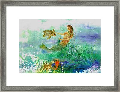 Mermaid And Baby Loggerhead Turtle Framed Print by Nancy Gorr