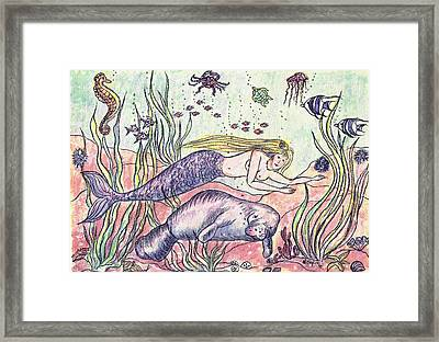 Mermaid And The Manatee Framed Print by Nancy Taylor