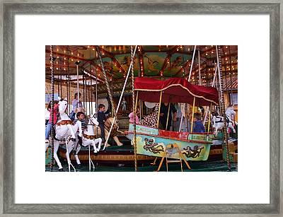 Merry Go Round Framed Print by Dany Lison