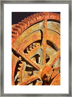 Meshing Gears Framed Print by Phyllis Denton