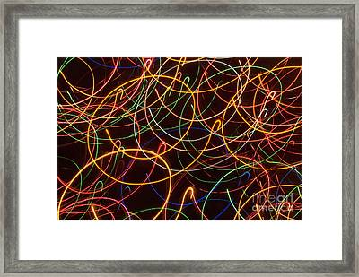 Messin' With The Christmas Tree Framed Print by Jim Wright