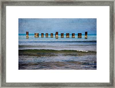 Metal Sentinals Framed Print by Jeanette Brown