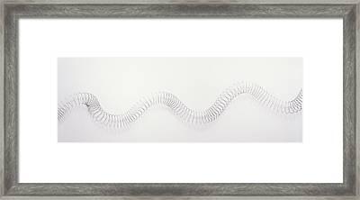 Metal Slinky Coil Manipulated Framed Print by Dorling Kindersley/uig