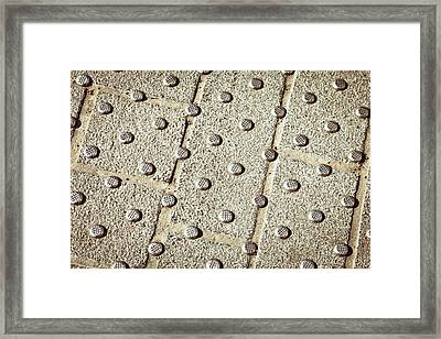 Metal Studs Framed Print