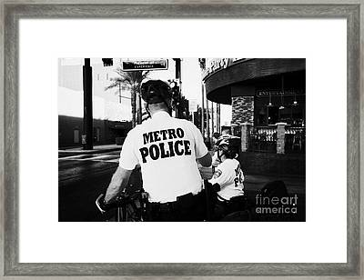 metro police bicycle cops in downtown Las Vegas Nevada USA Framed Print