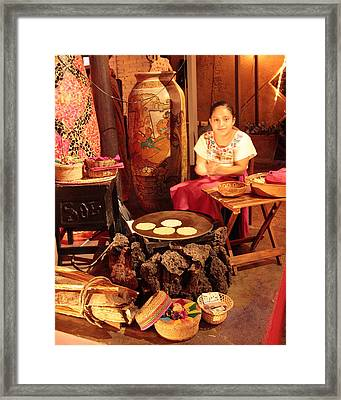 Mexican Girl Making Tortillas Framed Print by Roupen  Baker