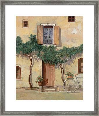 Mezza Bicicletta Sul Muro Framed Print