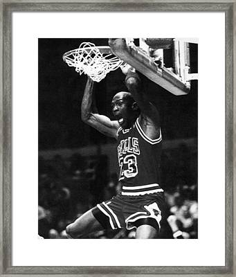 Michael Jordan Dunks Framed Print by Retro Images Archive