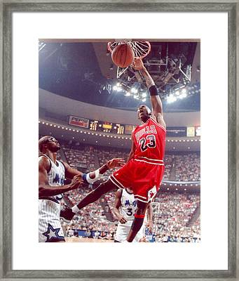 Michael Jordan Dunks With Left Hand Framed Print by Retro Images Archive