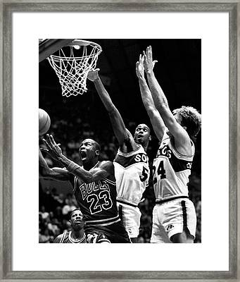 Michael Jordan Going For A Hard Layup Framed Print