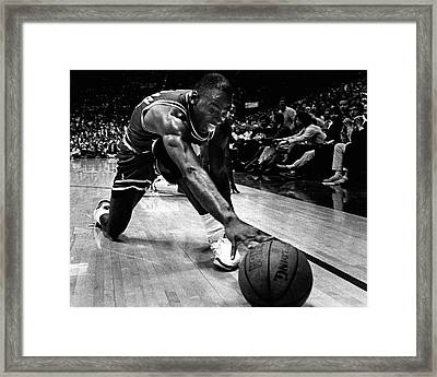 Michael Jordan Reaches For The Ball Framed Print