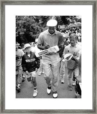 Michael Jordan Signing Autographs Framed Print by Retro Images Archive