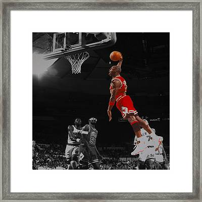 Michael Jordan Tongue Out Cradle Dunk Framed Print by Brian Reaves