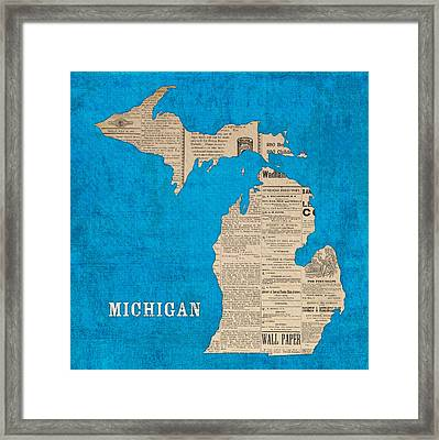 Michigan Map Made Of Vintage Newspaper Clippings On Blue Canvas Framed Print by Design Turnpike