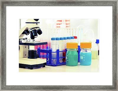Microscope And Chemicals Framed Print