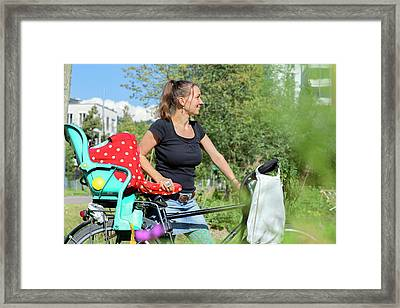 Mid Adult Woman With Bicycle In Garden Framed Print