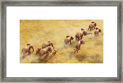 Migration Of Giants Framed Print by Gary Hanna